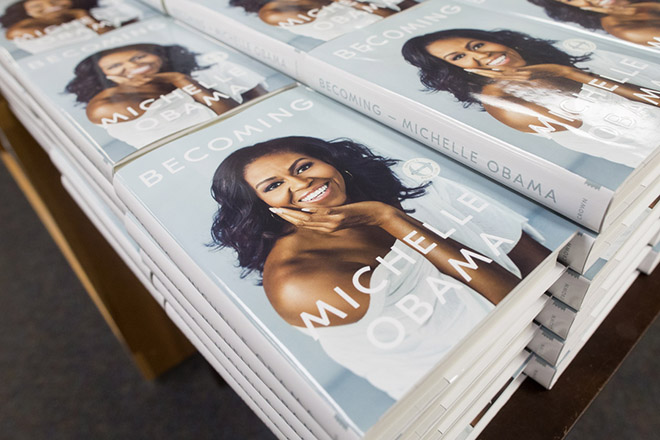epa07162843 Copies of the book 'Becoming' by former US First Lady Michelle Obama are for sale at Politics and Prose Bookstore in Washington, DC, USA, 13 November 2018. The new memoir by Michelle Obama has the global publication date of 13 November.  EPA/MICHAEL REYNOLDS