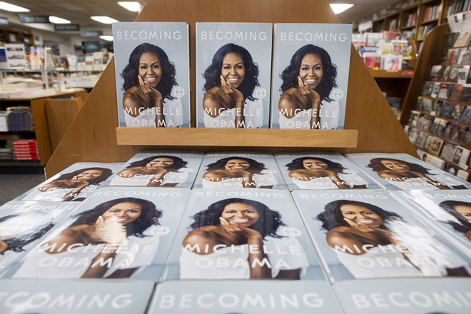 epa07162844 Copies of the book 'Becoming' by former US First Lady Michelle Obama are for sale at Politics and Prose Bookstore in Washington, DC, USA, 13 November 2018. The new memoir by Michelle Obama has the global publication date of 13 November.  EPA/MICHAEL REYNOLDS