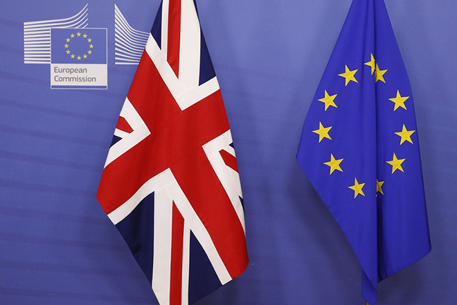 epa07186750 A British (L) and European Union flag are set up before British Prime Minister Teresa May and European Commission President Jean-Claude Juncker are to meet at the EU Commission headquarter in Brussels, Belgium, 24 November 2018. The British Prime Minister and EU Commission president Juncker will meet to discuss the future ties between the UK and the European Union, one day ahead of a special meeting of the European Council on Britain leaving the EU under Article 50, also dubbed the 'Brexit'. EU27 leaders will meet to endorse the draft Brexit withdrawal agreement and to approve the draft political declaration on future EU-UK relations on Sunday 25 November 2018, the European Council announced in its calendar.  EPA/JULIEN WARNAND