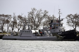 epa07190551 A Ukrainian warship and a tugboat stand in a port in the Crimean city of Kerch after they were captured by the Russian Border Guard Service and escorted there, 26 November 2018. Three Ukrainian warships attempted to violate the Russian maritime border and were shot dead by border guards. Three Ukrainian sailors were injured in the incident and received medical assistance, all others are detained.  EPA/STRINGER