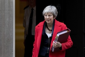 Theresa May heads for Prime Minister's Questions at The House of Commons
