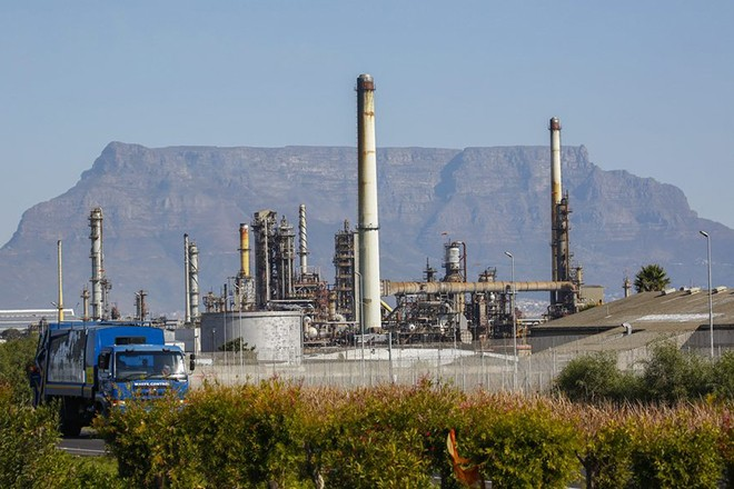 epa05312159 A vehicle passes the Chevron Oil Refinery in Cape Town, South Africa, 17 May 2016. According to reports, continued petrol price increases in 2016 have had a ripple effect across commodity prices, inflation and interest rates. The California based US company Chevron's South African unit operates a 110,000 barrel a day refinery in Cape Town.  EPA/NIC BOTHMA
