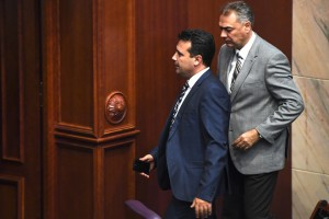 epa07105805 Macedonian Prime Minister Zoran Zaev (L) leaves the parliament after voting for the start changing the state's constitution on the parliamentary session in Skopje, The Former Yugoslav Republic of Macedonia (FYROM), 19 October 2018. Two thirds (80 members of the parliament) of Macedonian parliament voted to start changing the state's constitution and constitutional changes to change the name of the country in North Macedonia according to the deal with Greece.  EPA/GEORGI LICOVSKI