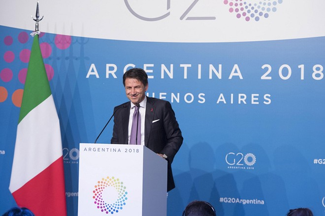 epa07202510 A handout photo made available by the Chigi Palace Press Office shows Italian Prime Minister Giuseppe Conte speaking during a press conference after the G20 summit in Buenos Aires, Argentina, 01 December 2018. The G20 Summit brings together the heads of State or Government of the 20 largest economies and takes place from 30 November to 01 December 2018.  EPA/FILIPPO ATTILI / CHIGI PALACE PRESS OFFICE / HANDOUT  HANDOUT EDITORIAL USE ONLY/NO SALES