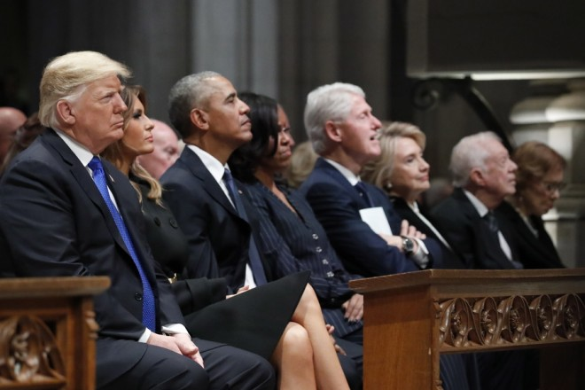 epa07210565 (L-R) US President Donald J. Trump, first lady Melania Trump, former US President Barack Obama, Michelle Obama, former US President Bill Clinton, former Secretary of State Hillary Clinton, and former US President Jimmy Carter listen as former US President George W. Bush speaks during a State Funeral at the National Cathedral, in Washington, DC, USA, 05 December 2018. George H. W. Bush, the 41st President of the United States (1989-1993), died in his Houston, Texas, USA, home surrounded by family and friends on 30 November 2018. The body will return to Houston for another funeral service before being transported by train to the George Bush Presidential Library and Museum for internment.  EPA/ALEX BRANDON / POOL