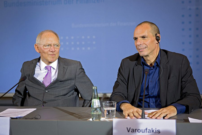 epa04604453 German Finance Minister Wolfgang Schaeuble (L) and Greek Finance Minister Yanis Varoufakis (R) sit for a joint press conference in Berlin, Germany, 05 February 2015. The meeting between Varoufakis and Schaeuble comes after the European Central Bank (ECB) decided to turn up the pressure on Greece over its vow to renegotiate the terms of its bailout by refusing to accept Greek government bonds as security for loans.  EPA/MICHAEL KAPPELER