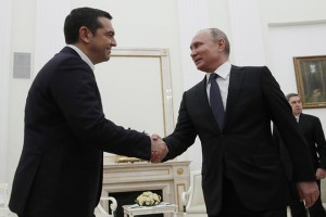 epa07214488 Russian President Vladimir Putin (front R) shakes hands with Greek Prime Minister Alexis Tsipras (L) during their meeting in the Kremlin in Moscow, Russia, 07 December 2018. Alexis Tsipras is on a working visit in Russia.  EPA/MAXIM SHEMETOV / POOL