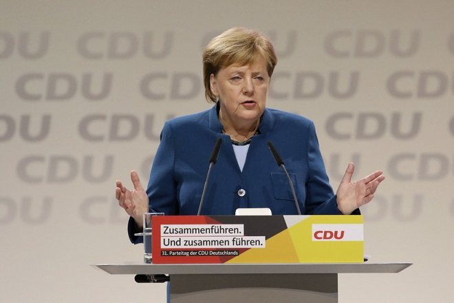 epa07214542 German Chancellor Angela Merkel holds a speech during the 31st Party Congress of the Christian Democratic Union (CDU) in Hamburg, Germany, 07 December 2018. At the party congress, a new party leader is to be elected. Associated with the new party leader is the debate over the fundamental political orientation of the CDU after Chancellor Merkel will no longer hold this office.  EPA/FOCKE STRANGMANN