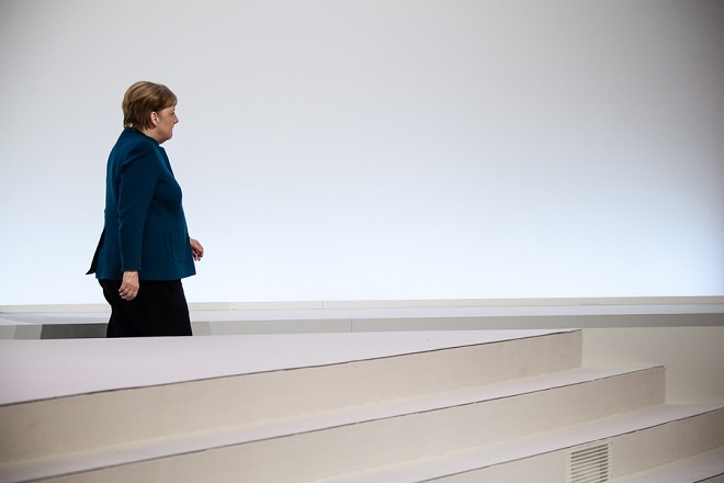 epa07214580 German Chancellor Angela Merkel leaves the stage during the 31st Party Congress of the Christian Democratic Union (CDU) in Hamburg, Germany, 07 December 2018. At the party congress, a new party leader is to be elected. Associated with the new party leader is the debate over the fundamental political orientation of the CDU after Chancellor Merkel will no longer hold this office.  EPA/CLEMENS BILAN