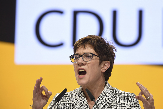 epa07214628 The candidate for the leadership of the German Christian Democratic Union (CDU), Annegret Kramp-Karrenbauer holds her application speech during the 31st Party Congress of the Christian Democratic Union (CDU) in Hamburg, Germany, 07 December 2018. At the party congress, a new party leader is to be elected. Associated with the new party leader is the debate over the fundamental political orientation of the CDU after Chancellor Merkel will no longer hold this office.  EPA/CLEMENS BILAN