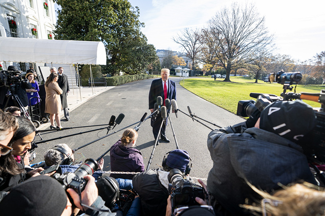 epa07214941 US President Donald J. Trump (C) announces that he is nominating William Barr to lead the Justice Department and Heather Nauert to be the next UN ambassador, as he speaks to the media outside of the White House in Washington, DC, USA, 07 December 2018. Trump was leaving the White House for an event in Kansas City.  EPA/JIM LO SCALZO
