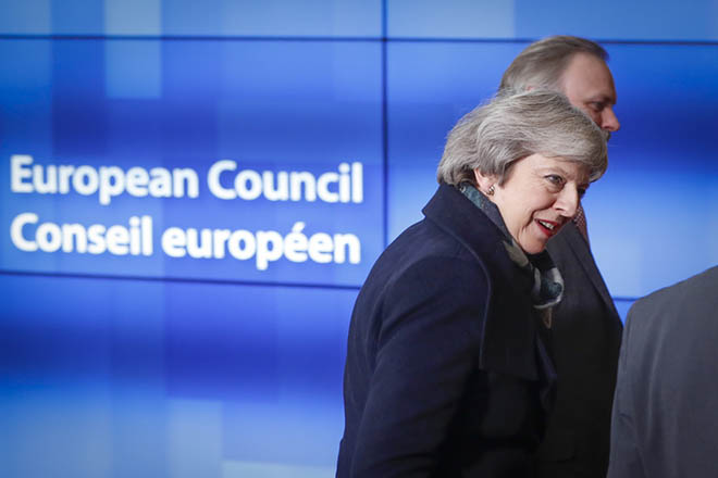 epa07224018 British Prime Minister Theresa May arrives for a meeting with European Council President Donald Tusk (unseen) at the European Council in Brussels, Belgium, 11 December 2018. British Prime Minister Theresa May postponed the Brexit deal Meaningful Vote, on 11 December 2018 due to risk of rejection from Members of Parliament. Theresa May is currently on a whistle stop tour of Europe calling on the leaders of the Netherlands, Germany and EU in Brussels looking for new guide lines for her Northern Ireland backstop.  EPA/OLIVIER HOSLET