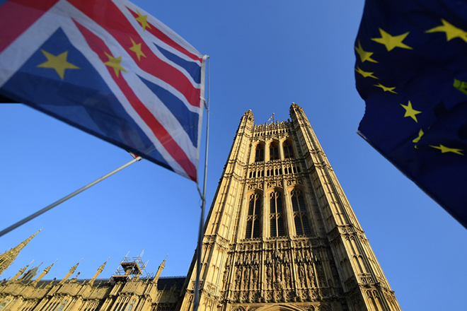 epa07223928 Pro EU protesters fly the Union and EU flags outside the British Houses of Parliament in central London, Britain, 11 December 2018 after British Prime Minister Theresa May's decision to postpone the Brexit deal Meaningful Vote, due to risk of rejection from Members of Parliament. Theresa May is currently on a whistle stop tour of Europe calling on the leaders of the Netherlands, Germany and EU in Brussels looking for new guide lines for her Northern Ireland backstop.  EPA/ANDY RAIN