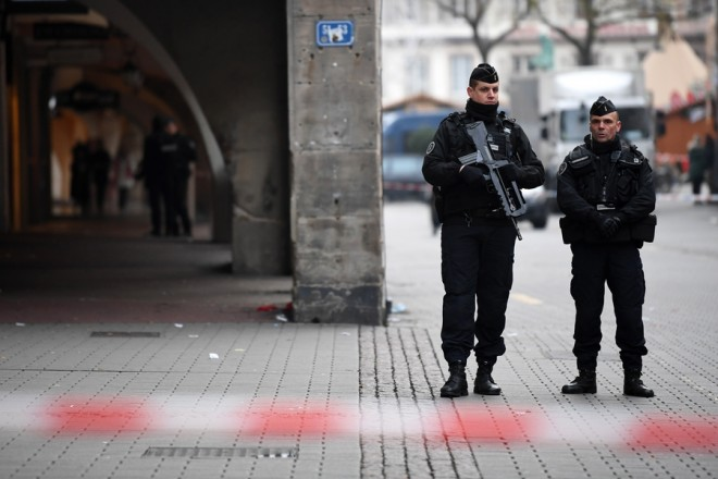 epa07225388 Police officers stand guard near the Christmas Market where a deadly shooting took place, in Strasbourg, France, 12 December 2018. According to latest reports, two people were killed and 14 people were injured. The gunman is reported to be at large and the motive for the attack is still unclear.  EPA/PATRICK SEEGER