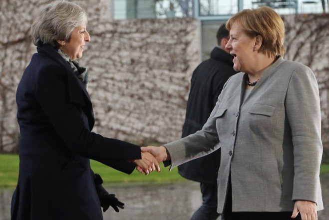 epa07223457 German Chancellor Angela Merkel (R) welcomes British Prime Minister Theresa May (L) at the Chancellery in Berlin, Germany, 11 December 2018. British Prime Minister Theresa May postponed the Brexit deal Meaningful Vote, on 11 December 2018 due to risk of rejection from Members of Parliament. Theresa May is currently on a whistle stop tour of Europe calling on the leaders of the Netherlands, Germany and EU in Brussels looking for new guide lines for her Northern Ireland backstop.  EPA/FILIP SINGER