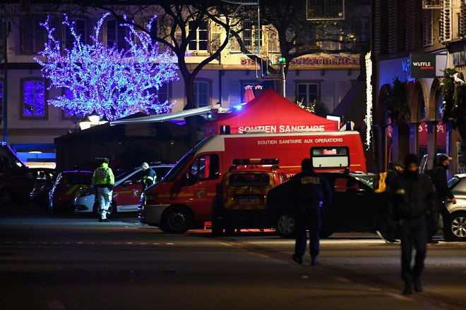 epaselect epa07224953 Authorities work at a makeshift emergency services base after a deadly shooting in Strasbourg, France, early 12 December 2018. According to the latest reports, four people were killed. According to reports, four people have been killed and more than 10 people have been injured after a deadly attack at the Christmas market in Strasbourg. The gunman is reported to be at large and the motive for the attack is still unclear.  EPA/PATRICK SEEGER