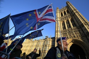 epa07223948 Pro EU protesters demonstrate outside the British Houses of Parliament in central London, Britain, 11 December 2018 after British Prime Minister Theresa May's decision to postpone the Brexit deal Meaningful Vote, due to risk of rejection from Members of Parliament. Theresa May is currently on a whistle stop tour of Europe calling on the leaders of the Netherlands, Germany and EU in Brussels looking for new guide lines for her Northern Ireland backstop.  EPA/ANDY RAIN