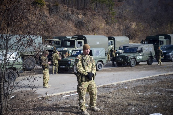 epa07184824 Hungarian soldiers, part of the KFOR mission in Kosovo, seen in the village of in the village of Rudare in Serbia, near the ethnically divided town of Mitrovica in Kosovo, 23 November 2018 as Kosovo Serbs protested against the decision of Kosovo's government of a 100-per cent import tax on all goods imported from Serbia and Bosnia.  EPA/STRINGER