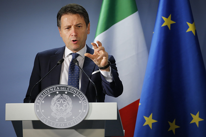 epa07231518 Italian Prime Minister Giuseppe Conte speaks at a news conference after the end of the European Council in Brussels, Belgium, 14 December 2018. On the second day of summit EU leader again focussed on the conclusions on the Single Market, climate change, migration, disinformation, the fight against racism and xenophobia, and citizens' consultations.  EPA/JULIEN WARNAND
