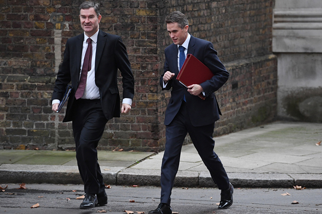 epa07238218 Britain's Justice Secretary and Lord Chancellor David Gauke (L) and Britain's Defence Secretary Gavin Williamson (R) arrives to a cabinet meeting in n10 Downing Street in London, Britain, 18 December 2018. Britain's opposition Labour Party leader Jeremy Corbyn has tabled a motion of no confidence in Prime Minister Theresa May, after she said MPs would not vote on the Brexit deal until 14 January 2019.  EPA/FACUNDO ARRIZABALAGA
