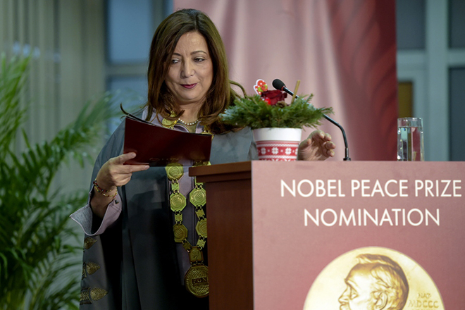 epa07238377 Tunisian economist Uided Bushamaui, one of the 2015 Nobel Peace Prize winners, announces her proposal to nominate the two prime ministers of Macedonia and Greece, Zoran Zaev and Alexis Tsipras, for the Nobel Peace Prize for signing a landmark agreement between their countries in Skopje, the Former Yugoslav Republic of Macedonia on 18 December 2018.  EPA/NAKE BATEV