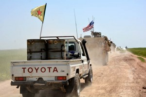epa07240226 (FILE) - A convoy of US army troops (R) and the People's Protection Units (YPG) Kurdish militia (L) patrol near al-Ghanamya village, al-Darbasiyah town at the Syrian-Turkish border, Syria, 29 April 2017 (reissued 19 December 2018). US media reports on 19 December 2018 state USA may be in process of withdrawing all of its troops from Syria. An estimated 2,000 US troops, mainly located in Syria's north-east region, are in Syria with their primary task being the training of local units in their fight against the IS, the Islamic State militants.  EPA/YOUSSEF RABIE YOUSSEF