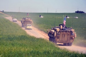 epa07240227 (FILE) - A convoy of US army troops and the People's Protection Units (YPG) Kurdish militia patrol near al-Ghanamya village, al-Darbasiyah town at the Syrian-Turkish border, Syria, 29 April 2017 (reissued 19 December 2018). US media reports on 19 December 2018 state USA may be in process of withdrawing all of its troops from Syria. An estimated 2,000 US troops, mainly located in Syria's north-east region, are in Syria with their primary task being the training of local units in their fight against the IS, the Islamic State militants.  EPA/YOUSSEF RABIE YOUSSEF