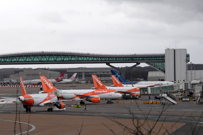 epa07243265 Planes are parked on a tarmac of the Gatwick airport in Sussex, southeast, England, 21 December 2018. Britain's second busiest airport Gatwick was shut down by authorities after sightings of drones flying but has since then reopened.  EPA/FACUNDO ARRIZABALAGA