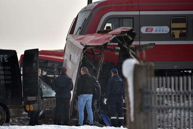 epa07243191 Officers at the scene of crash between a bus and a train at a railway crossing in the village of Donje Medjurovo, some 10km from the city of Nis, Serbia, 21 December 2018. According to reports, the train slammed into a bus, which transported passengers from Donje Medjurovo to Nis, at a railway crossing that did not reportedly have a level crossing. Five people were killed and over 20 were injured, media added.  EPA/DJORDJE SAVIC