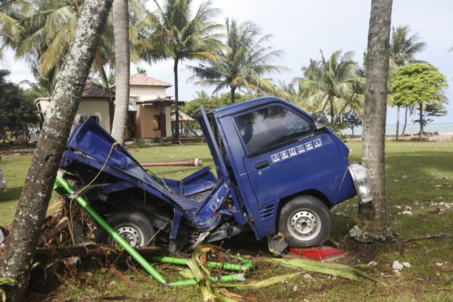 epa07247175 A car sits among debris at a resort after a tsunami hit the Sunda Strait in Tanjung Lesung, Banten, Indonesia, 24 December 2018. According to the Indonesian National Board for Disaster Management (BNPB), at least 281 people are dead and 1,016 others have been injured after a tsunami hit the coastal regions of the Sunda Strait on 22 December.  EPA/ADI WEDA