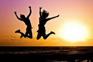 young people women jump happy happiness sunset