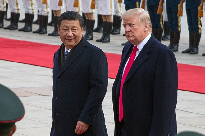 epa07253209 (FILE) - US President Donald J. Trump (R) and Chinese President Xi Jinping (L) review soldiers of the Chinese People's Liberation Army honor guard during a welcome ceremony at the Great Hall of the People in Beijing, China, 09 November 2017 (reissued 29 December 2018). Trump said on Twitter on 29 December 2018 that he had a 'long and very good call' with Chinese President Xi Jinping on a possible trade deal between the United States and China.  EPA/ROMAN PILIPEY