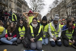 epa07264933 Protesters take part in a minute of silence  during a protest march during a women's 'Gilets Jaune' (Yellow Vests) between Place de la Bastille and Republique, in Paris, France, 06 January 2019. The women's protest comes one day after a large Yellow Vest protest in Paris, dubbed 'Act VIII', as it was the eighth national protest on a Saturday, which saw sporadic clashes with riot police and burning barricades in central Paris. The so-called 'gilets jaunes' (yellow vests) is a grassroots protest movement with supporters from a wide span of the political spectrum, that originally started with protest across the nation in late 2018 against high fuel prices. The movement in the meantime also protests the French government's tax reforms, the increasing costs of living and some even call for the resignation of French president Emmanuel Macron.  EPA/IAN LANGSDON