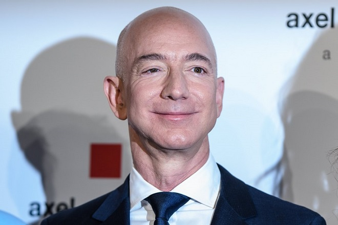 epa06689581 Amazon CEO Jeff Bezos attends the Axel Springer Award 2018, in Berlin, Germany, 24 April 2018. Amazon CEO Bezos, who also owns US newspaper 'Washington Post', is awarded with the Axel Springer Award. Axel Springer SE is one of the largest digital publishing houses in Europe and owner of numerous multimedia news brands.  EPA/CLEMENS BILAN
