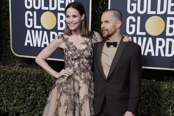 epa07266792 Sam Rockwell (R) and Leslie Bibb arrive for the 76th annual Golden Globe Awards ceremony at the Beverly Hilton Hotel, in Beverly Hills, California, USA, 06 January 2019.  EPA/MIKE NELSON