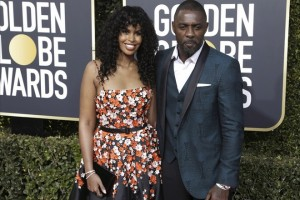epa07266661 Sabrina Dhowre (R) and Idris Elba arrive for the 76th annual Golden Globe Awards ceremony at the Beverly Hilton Hotel, in Beverly Hills, California, USA, 06 January 2019.  *** Local Caption *** 52514391  EPA/MIKE NELSON *** Local Caption *** 52514391