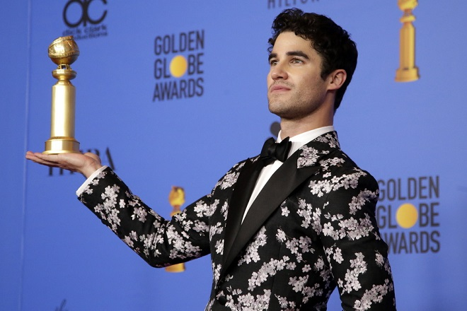 epa07266997 Darren Criss poses with the awards for Performance by an Actor in a Limited Series or Motion Picture Made for Televison for 'The Assassination of Gianni Versace : American Crime Story' in the press room during the 76th annual Golden Globe Awards ceremony at the Beverly Hilton Hotel, in Beverly Hills, California, USA, 06 January 2019.  EPA/MIKE NELSON