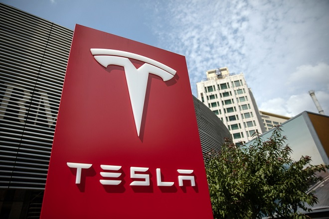 epa07003321 (FILE) - A Tesla sign is seen near Tesla China headquarters in Beijing, China, 25 July 2018 (reissued 07 September 2018). Reports on 07 September 2018 state Tesla shares lost 10 per cent in value at the start of trading on Wall Street following news Tesla's chief accounting officer Dave Morton had tendered his resignation on 04 September.  EPA/ROMAN PILIPEY