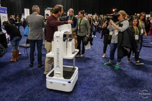 epa07267032 A member of the media makes a video featuring a robot during the 'CES Unveiled Las Vegas' press event at the 2019 International Consumer Electronics Show in Las Vegas, Nevada, USA, 06 January 2019. The annual CES, which takes place from 08 to 11 January, is a place where industry manufacturers, advertisers and tech-minded consumers converge to get a taste of new innovations coming to the market each year.  EPA/LARRY W SMITH