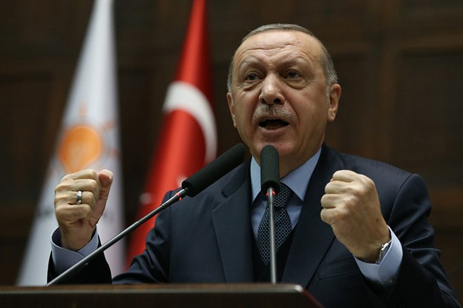 epa07269115 Turkish President Recep Tayyip Erdogan addresses members of ruling Justice and Development Party (AKP) at their group meeting at the parliament in Ankara, Turkey, 08 January 2019. According to reports, Erdogan criticized recent remarks made by US National Security Advisor John Bolton on Kurdish militants in Syria. Bolton on 07 January in Israel said that US troops would not leave Syria until Turkey agrees not to attack Kurdish forces in Syria.  EPA/STR