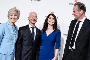 epa06689602 (L-R) German publisher Axel Springer's widow Friede Springer, Amazon CEO Jeff Bezos, his wife MacKenzie Bezos, and Axel Springer SE CEO Mathias Doepfner attend the Axel Springer Award 2018, in Berlin, Germany, 24 April 2018. Amazon CEO Bezos, who also owns US newspaper 'The Washington Post', is awarded with the Axel Springer Award. Axel Springer SE is one of the largest digital publishing houses in Europe and owner of numerous multimedia news brands.  EPA/CLEMENS BILAN
