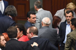 epa07105802 Members of the parliament congratulate to Macedonian Prime Minister Zoran Zaev (C) after voting for the start changing the state's constitution on the parliamentary session in Skopje, The Former Yugoslav Republic of Macedonia (FYROM), 19 October 2018. Two thirds (80 members of the parliament) of Macedonian parliament voted to start changing the state's constitution and constitutional changes to change the name of the country in North Macedonia according to the deal with Greece.  EPA/GEORGI LICOVSKI