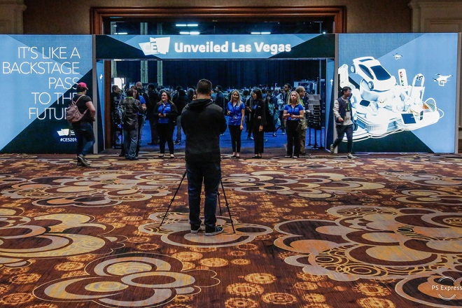 epa07266586 A man takes a picture of the entrance during the CES Unveiled Las Vegas at the 2019 International Consumer Electronics Show in Las Vegas, Nevada, USA, 06 January 2019. The annual CES which takes place from 8-11 January is a place where industry manufacturers, advertisers and tech-minded consumers converge to get a taste of new innovations coming to the market each year.  EPA/Larry W Smith
