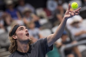 epa07272368 Stefanos Tsitsipas of Greece serves to Andreas Seppi of Italy during the Sydney International tennis tournament at Sydney Olympic Park Tennis Centre in Sydney, Australia, 10 January 2019.  EPA/CRAIG GOLDING AUSTRALIA AND NEW ZEALAND OUT