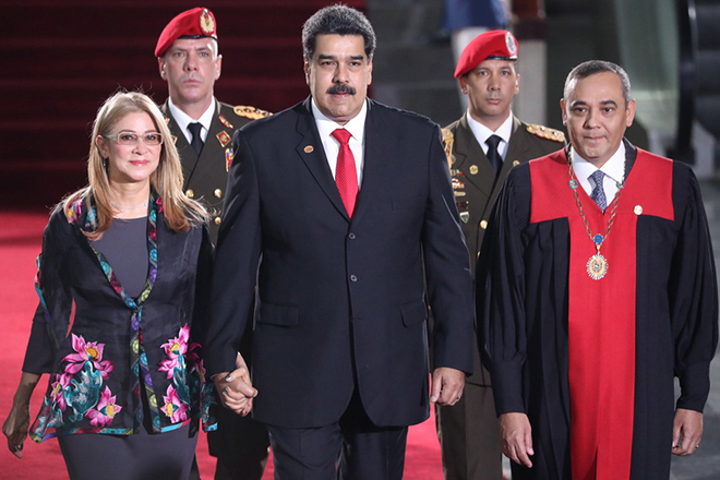 epa07273636 President of Venezuela, Nicolas Maduro (C), arrives at his investiture ceremony where he will be sworn in for a second term in office that will keep him in power until 2025, along with his wife Cilia Flores (L) and President of the Supreme Court of Justice (TSJ), Maikel Moreno (R), in Caracas, Venezuela, 10 January 2019. Maduro took the second term oath of office before the Supreme Court of Justice (TSJ) accompanied by six other heads of state, who are the only ones present for the second-term inauguration opposed to by opponents and good part of the international community.  EPA/MIGUEL GUTIERREZ