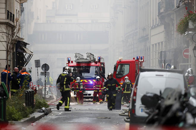 epa07276883 Firefighters work at the scene of an explosion at a bakery near Rue de Trevise in Paris, France, 12 January 2019. According to police, a suspected gas leak has lead to an explosion of a bakery in Paris, injuring several people and damaging surrounding buildings.  EPA/IAN LANGSDON