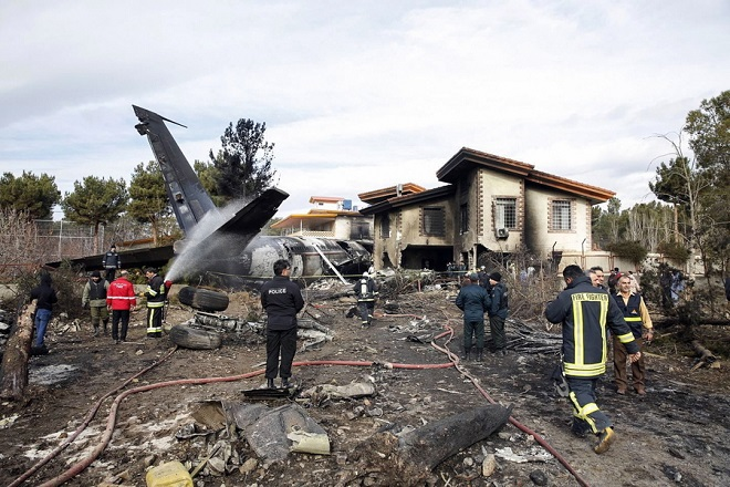 epa07281966 A general view shows the wreckage of a Boeing 707 cargo plane that crashed while landing at Fath airport, near the city of Karaj, Alborz province, Iran, 14 January 2019. According to media reports, at least seven members of the crew have been killed in the accident. One person has reportedly survived, media added.  EPA/HASSAN SHIRAVANI