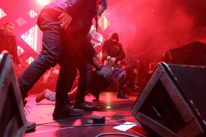 epa07282759 A handout photo made available by the City of Gdansk shows security staff trying to stop a man after he attacked Mayor of Gdansk Pawel Adamowicz during the 27th finale of the Great Orchestra of Christmas Charity in Gdansk, Poland, 13 January 2019 (issued 14 January 2019). Adamowicz was attacked with a sharp instrument by a 27-year-old male with a criminal record, during the concert associated with the 27th finale of the Great Orchestra of Christmas Charity in Gdansk on 13 January 2019. According to reports, Adamowicz suffered wounds to the heart and abdomen. Doctors reanimated Adamowicz on the spot and then transported him to a Gdansk Medical University hospital, where he underwent five hours of surgery. His condition is serious.  EPA/GRZEGORZ MEHRING / WWW.GDANSK.PL HANDOUT HANDOUT EDITORIAL USE ONLY NO SALES POLAND OUT HANDOUT EDITORIAL USE ONLY/NO SALES
