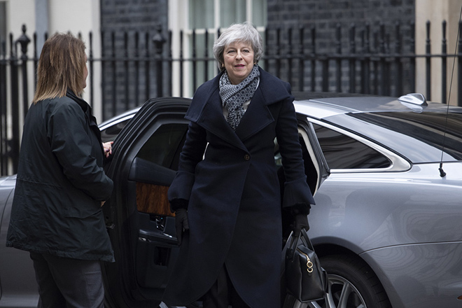 epa07283290 British Prime Minister, Theresa May arrives at 10 Downing street in central London, Britain, 14 January 2019 after giving a speech on Brexit to workers at the Portmeiron pottery factory in Stoke on Trent, central England. The postponed Brexit EU Withdrawal Agreement vote, or more commonly known as The Meaningful Vote, is due to be held in the House of Commons on 15 January 2019.  EPA/FACUNDO ARRIZABALAGA