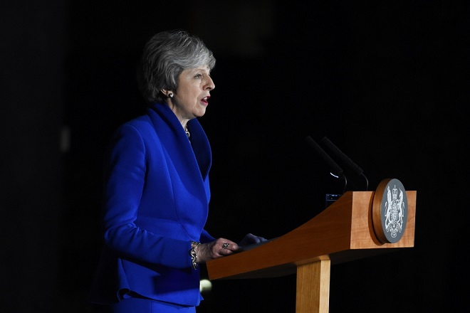 epa07291046 Britain's Prime Minister Theresa May makes a statement at Downing Street in London, Britain 16 January 2019. She won a Vote of no confidence in the government brought about by Leader of the Opposition Jeremy Corbyn after she lost the parliamentary vote on the EU withdrawal agreement.  EPA/FACUNDO ARRIZABALAGA